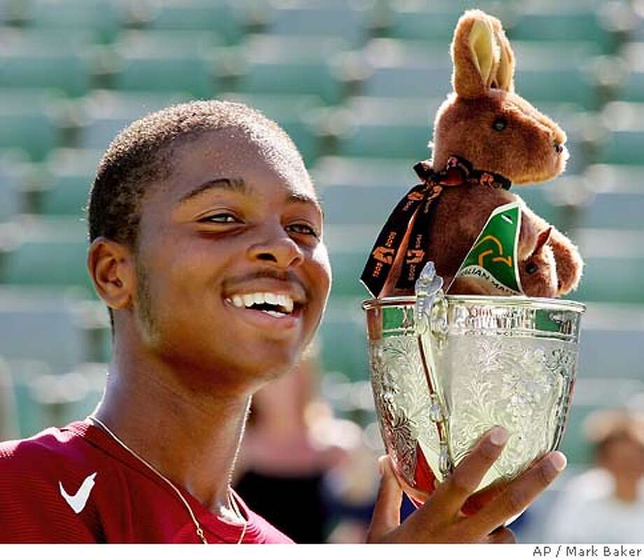 Donald Young of the U.S., holds the trophy aloft after his boys' singles final victory over South Korea's Kim Sun-yong at the Australian Open at Melbourne Park, Melbourne, Australia, Sunday, Jan. 30, 2005. Young won the title, 6-2, 6-4. (AP Photo/Mark Baker) Photo: MARK BAKER