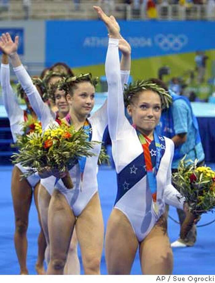 Courtney McCool, right, and Carly Patterson walk off with their medals after winning the silver during the women's gymnastics team final at the 2004 Summer Olympic Games in Athens, Tuesday, Aug. 17, 2004. (AP Photo/Sue Ogrocki) Photo: SUE OGROCKI