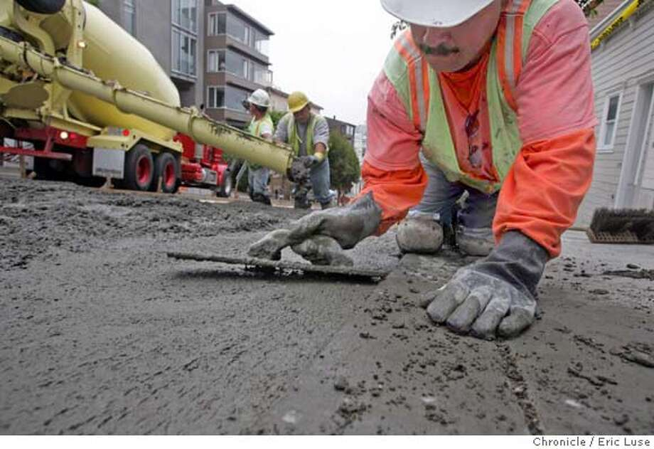 Arturo Aguayo works the edges with a hand float. Ghilotti Brothers Construction pouring a street on Chestnut Street in SF.  The price of cement has shot through the roof this year because of demand in China and the U.S. housing boom. Caltrans says the price per cubic yard for highway cement more than doubled between 2002 and 2004. San Francisco officials are bracing for future price spikes by adding 15 to 20 percent to existing construction budgets. Chestnut St. between Grant and Kearny - SF Dept. Public Works is doing a cement pour along Chestnut.  Event on 8/13/04 in San Francisco. Eric Luse / The Chronicle Photo: Eric Luse