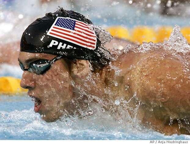 Golden retribution / Keller holds off Thorpe to give U.S ...