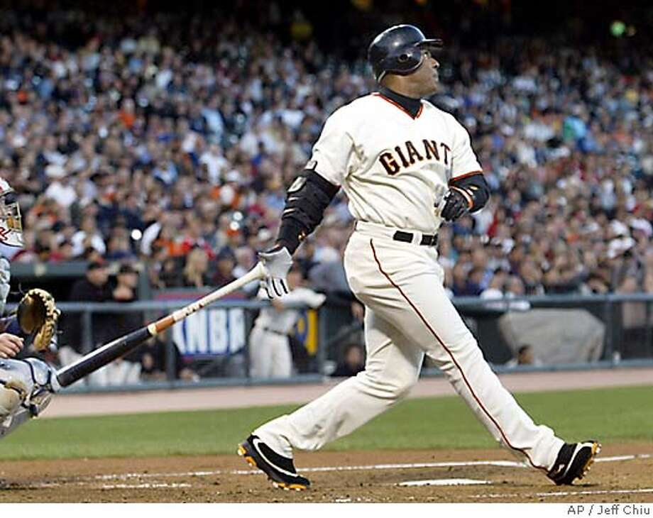San Francisco Giants' Barry Bonds watches the flight of his solo-home run, the 690th of his career, in the second inning against the Montreal Expos in San Francisco on Tuesday, Aug. 17, 2004. At left is Expos catcher Brian Schneider. (AP Photo/Jeff Chiu) Photo: JEFF CHIU