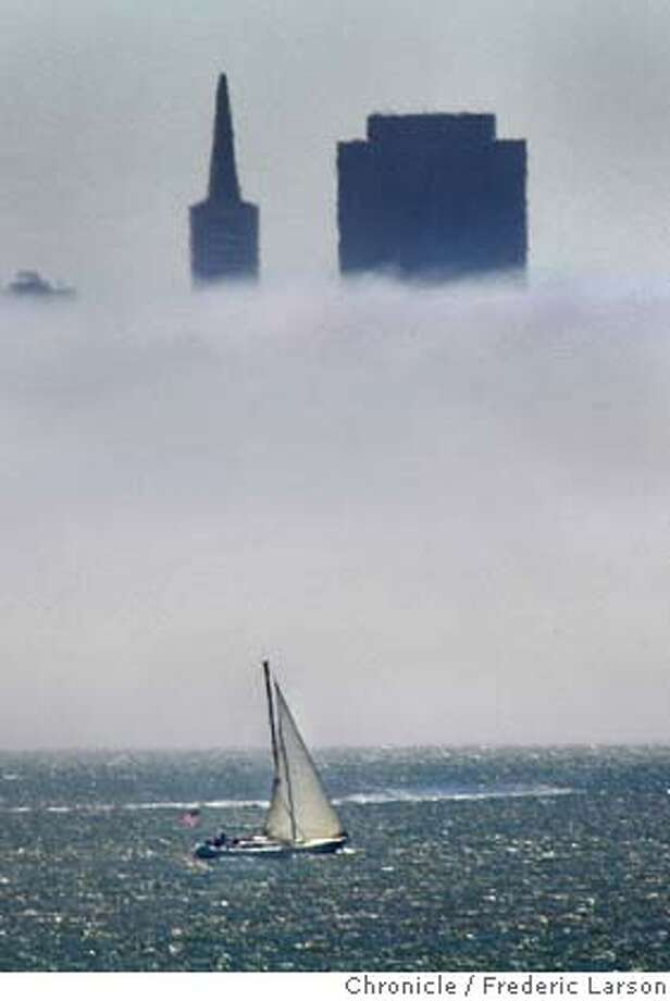 ; Point Richmond got a ocean breeze from the fog that rolled into the Bay Area as summer tempertures inland reached high in the 90's. The Bay Area later in the week is expected to cool down. Location:� 8/17/04  San Francisco Chronicle Frederic Larson Photo: Frederic Larson