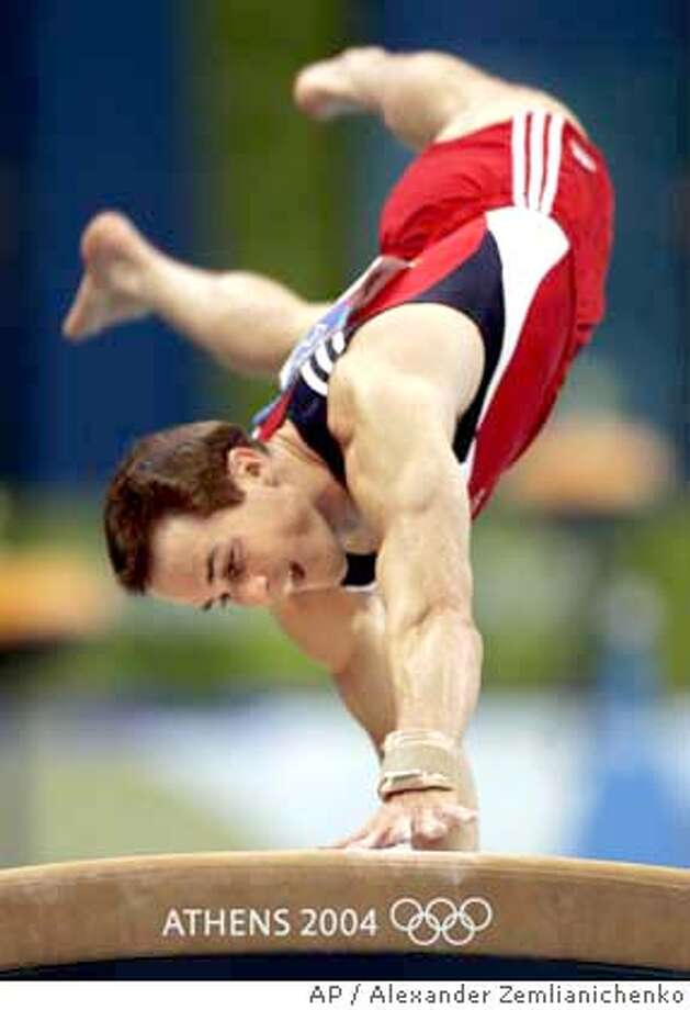 Morgan Hamm of the United States competes in the vault during the men's gymnastics team final at the 2004 Summer Olympic Games in Athens, Monday, Aug. 16, 2004. (AP Photo/Alexander Zemlianichenko) Photo: ALEXANDER ZEMLIANICHENKO