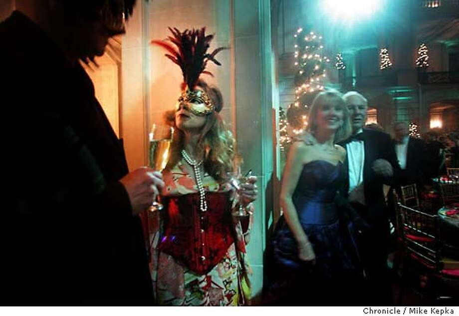 onlocationBallet092b_mk.jpg 6:01 p.m. Masquerading in a vintage Japanese kimono topped with a French corset and pearls, Diane Wynne of San Francisco finishes her martini in a corner of City Hall just as the dinner bells ring for dinner. ---- On Location at the Ballet Gala in San Francisco City Hall. 1/26/05  Mike Kepka/The Chronicle MANADATORY CREDIT FOR PHOTOG AND SF CHRONICLE/ -MAGS OUT Photo: Mike Kepka