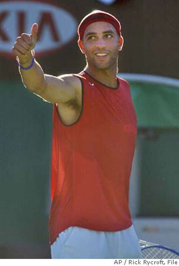 James Blake of the U.S. gives thumbs up during his 6-1,6-2,6-0 victory over Florian Mayer of Germany at the first round match at the Australian Open at Melbourne Park, Melbourne, Australia, Tuesday, Jan. 18, 2005. (AP Photo/Rick Rycroft) Ran on: 02-06-2005 Photo: RICK RYCROFT