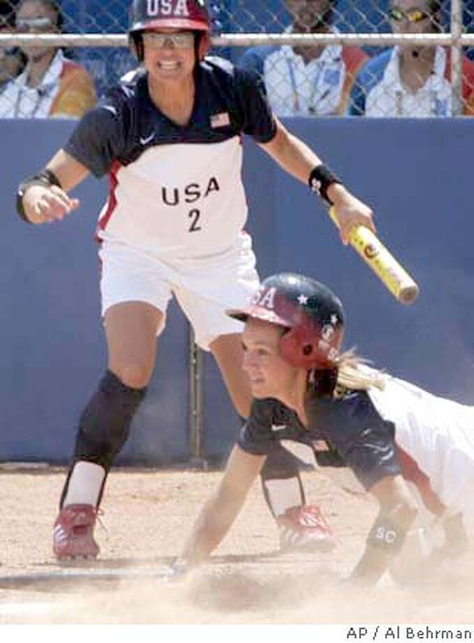 United States baserunner Amanda Freed, right, scores a run on a sacrifice fly by Jessica Mendoza (2) in the eighth inning against Japan, Monday, Aug. 16, 2004, during their softball game at the 2004 Olympic Games in Athens, Greece. The United States won 3-0. (AP Photo/Al Behrman) Photo: AL BEHRMAN