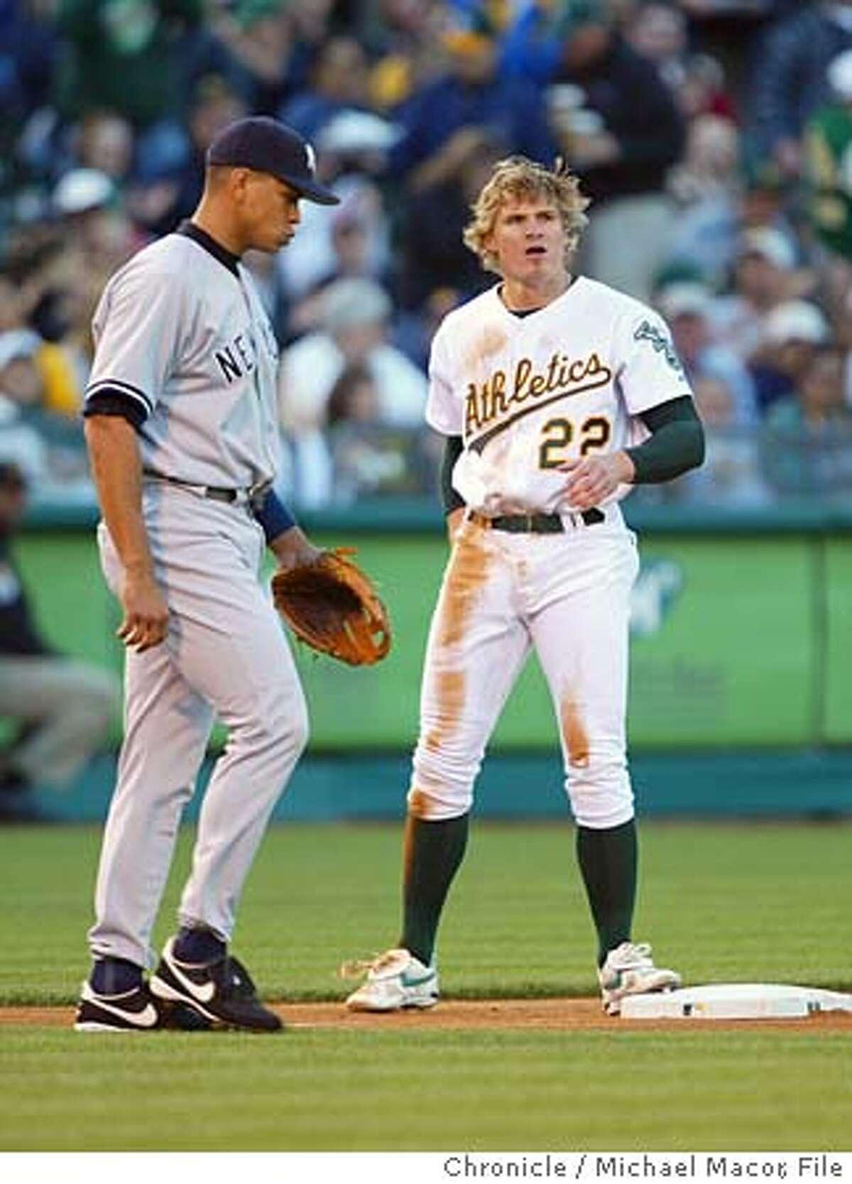 athletics057_mac.jpgOAkland's 22- Eric Byrnes steals 3rd base, Yankee's 3rd baseman 13- alex Rodriguez close by. Major League Baseball Oakland Atletics vs. New York Yankees event on 5/4/04 in Oakland Michael Macor / San Francisco Chronicle