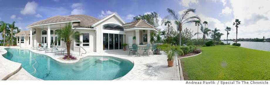 t pawlik3.jpg  MILLION06  FLORIDA Address: 2602 SW 51st St., Cape Coral, Florida Asking price: $1.1 million Square footage: 5,926 Built: 1995 Bedrooms: 3 Bathrooms: 2 �1�2 Land: �1�2 acre Garage: 4-plus cars The house, which sits on canals leading to the Gulf of Mexico, has 210 foot of water frontage, a boat launch, 42-foot long pool and a tiki-hut with grill. Many canals have posted speed limits to prevent boats from injuring manatees. Ran on: 02-06-2005  Photo caption Byline Andreas Pawlik