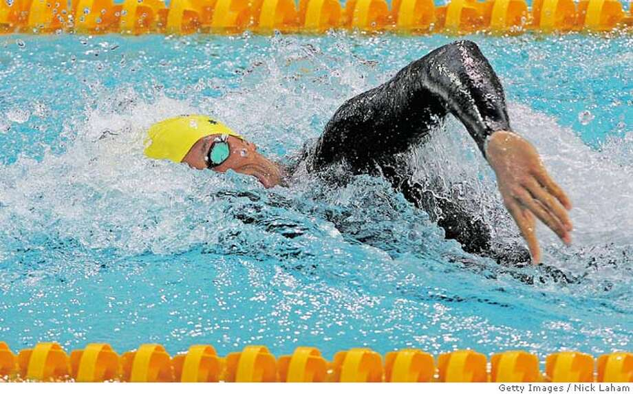 ATHENS - AUGUST 16: Ian Thorpe of Australia competes in the men's swimming 200 metre freestyle final on August 16, 2004 during the Athens 2004 Summer Olympic Games at the Main Pool of the Olympic Sports Complex Aquatic Centre in Athens, Greece. Thorpe won, Pieter Van Den Hoogenband of the Netherlands finished second and Michael Phelps of USA finished third. (Photo by Nick Laham/Getty Images) *** Local Caption *** Ian Thorpe Photo: Nick Laham