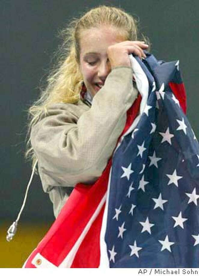 USA's Mariel Zagunis wipes her tears after she took the gold medal in the Women's Individual Sabre competition of the 2004 Olympic Games at the Helliniko fencing hall in Athens Tuesday, Aug. 17, 2004. (AP Photo/Michael Sohn) Photo: ALAISTAR GRANT