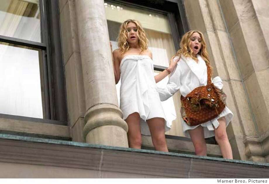 "ASHLEY OLSEN and MARY-KATE OLSEN star in Warner Bros.Pictures' action comedy ""New York Minute,"" distributed by Warner Bros. Pictures.  PHOTOGRAPHS TO BE USED SOLELY FOR ADVERTISING, PROMOTION, PUBLICITY OR REVIEWS OF THIS SPECIFIC MOTION PICTURE AND TO REMAIN THE PROPERTY OF THE STUDIO. NOT FOR SALE OR REDISTRIBUTION."