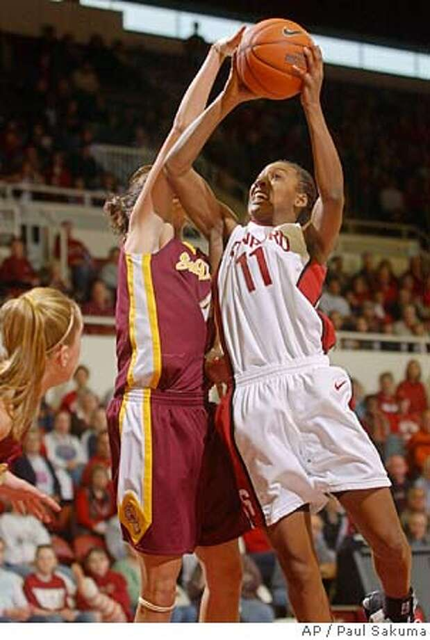 Stanford guard Candice Wiggins, right, drives to the basket in front of Arizona State forward Emily Westerberg, left, in the first half, Saturday, Feb. 5, 2005 in Stanford, Calif. (AP Photo/Paul Sakuma) Photo: PAUL SAKUMA
