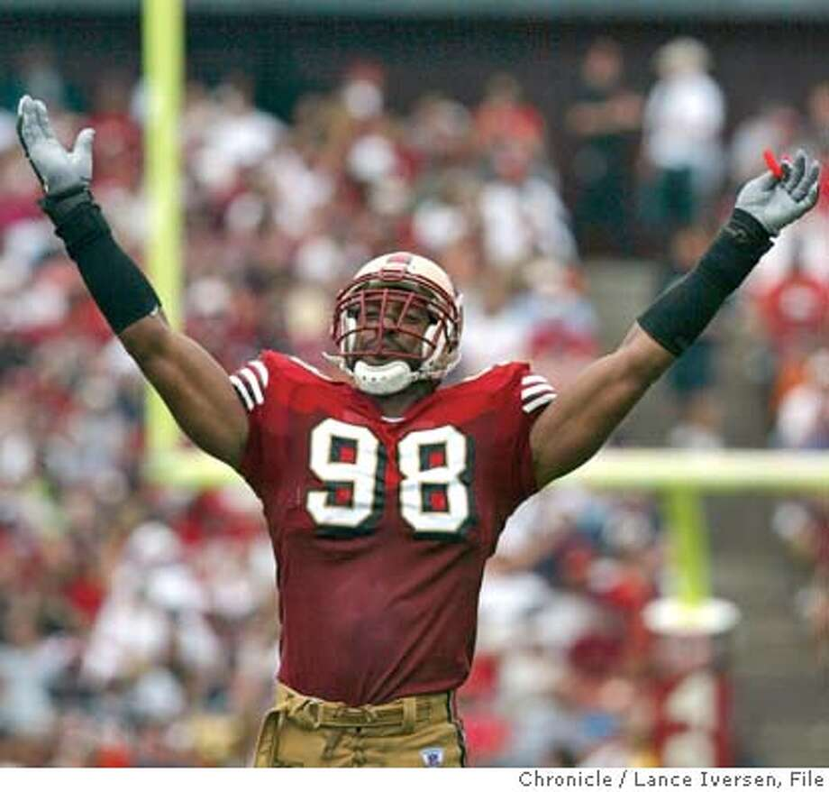 49ers_004_LI.JPG  San Francisco 49ers vs the Chicago Bears. Niners Julian Peterson pumps the crowd up during a defenses stand in the first half. Photo by LANCE IVERSEN, The San Francisco Chronicle Julian Peterson is regarded by some as the NFL's best linebacker, and other teams may try to take him from the 49ers. ALSO RAN: 12/30/2003  Photo caption onthenfl28_PH1062806400The Chronicle49ers_004_LI.JPG_San Francisco 49ers vs the Chicago Bears. Niners Julian Peterson pumps the crowd up during a defenses stand in the first half. Photo by LANCE IVERSEN, The San Francisco Chronicle__CAT use crop Julian Peterson is regarded by some as the NFL's best linebacker, and other teams may try to take him from the 49ers. CAT use crop Photo: Lance Iversen