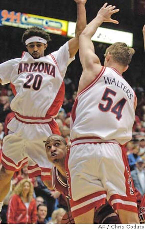 Arizona's Kirk Walters and Salim Stoudamire (20) trap Stanford's Rob Little during Stanford's game against No. 14 Arizona in McKale Center in Tucson, Ariz., Saturday Feb. 5, 2005. (Photo by Chris Coduto) Photo: Chris Coduto