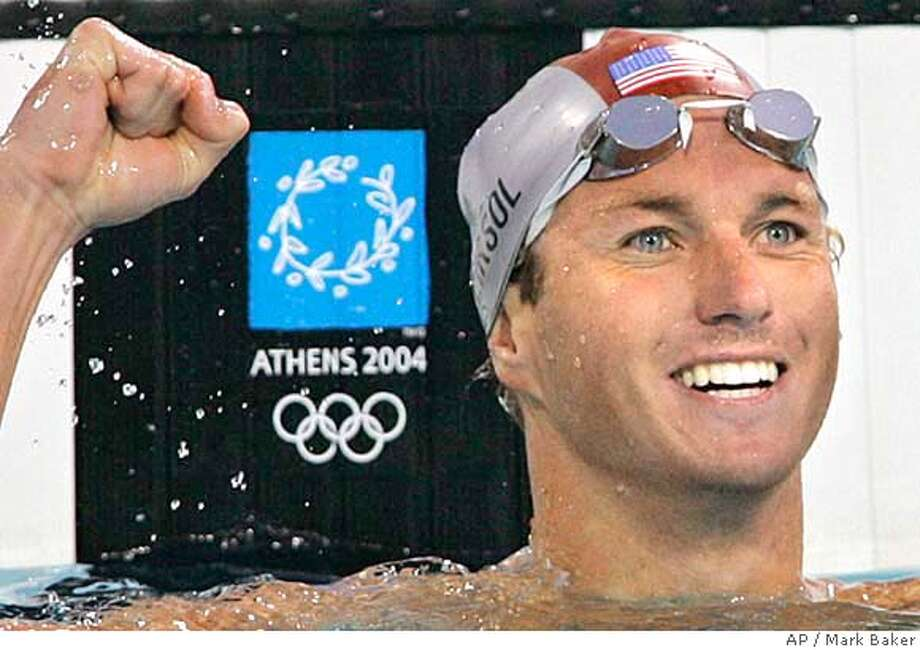 Aaron Piersol of the U.S. reacts after winning gold in the 100m backstroke at the 2004 Olympic Games Monday, August 16 2004 in Athens, Greece. (AP Photo/Mark Baker) Photo: MARK BAKER