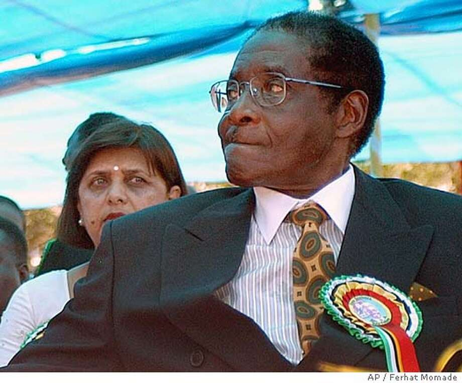 Zimbabwean President Robert Mugabe attends the inauguration ceremony for newly elected Mozambican President, Armando Guebuza, unseen, in neighbouring Maputo, Mozambique, Wednesday Feb. 2, 2005. Guebuza, replaces Joaquim Chissano who retired after 18 years in power. (AP Photo/Ferhat Momade) Photo: FERHAT MOMADE