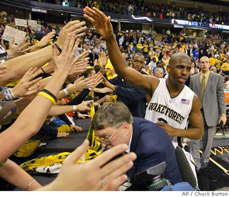 Wake Forest's Chris Paul (3) gives high fives to the student section after Wake Forest's 92-89 win over Duke in Winston-Salem, N.C., Wednesday Feb. 2, 2005. Paul had 23 points, six assists, and five steals. (AP Photo/Chuck Burton) Photo: CHUCK BURTON