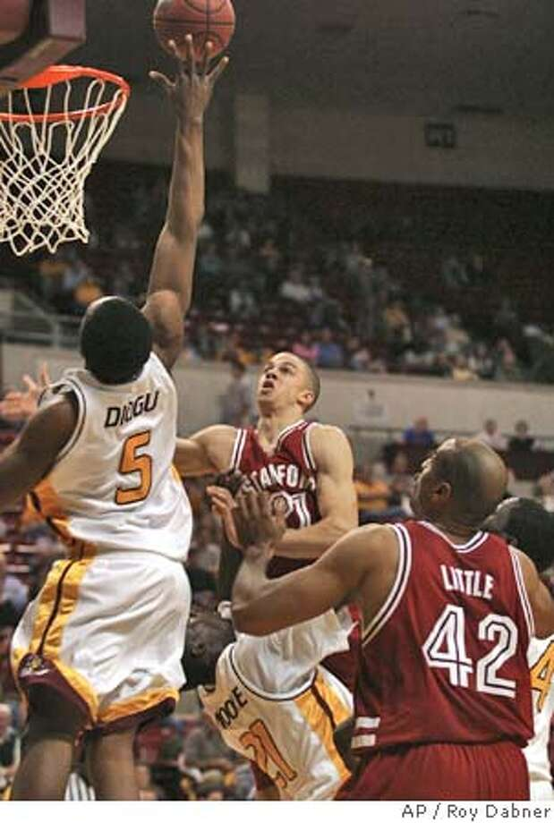 Stanford guard Nick Robinson, center, has his shot blocked by Arizona State's Ike Diogu, during the first half, Thursday, Feb. 3, 2005, in Tempe, Ariz.(AP Photo/Roy Dabner) Photo: ROY DABNER
