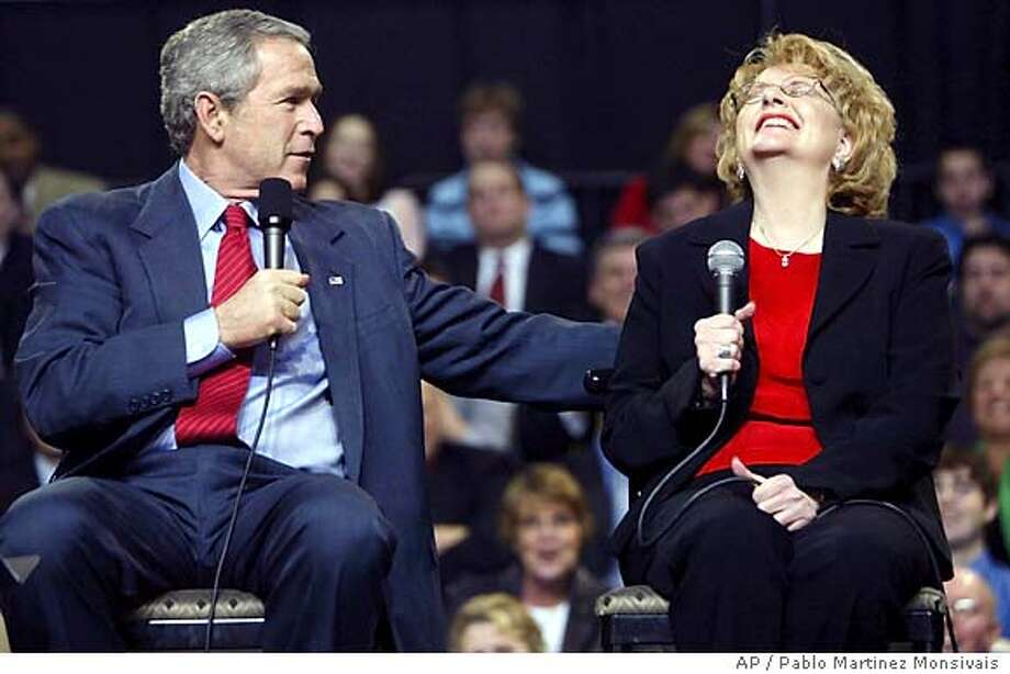 Mary Mornin, right, reacts as President Bush, left, responds to her question at Qwest Center Omaha Arena Friday, Feb. 4, 2005 in Omaha, Nebraska. Bush is on a five-state tour to sell the American public the agenda he laid out before Congress in his State of the Union address. Bush focused on his proposal to change the Social Security system, which he says is heading for bankruptcy. (AP Photo/Pablo Martinez Monsivais) Photo: PABLO MARTINEZ MONSIVAIS