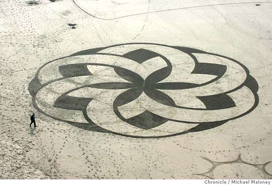 """FEATURE_014_MJM.jpg  Someone with an artistic eye and sense of grand scale sculpted this sand """"painting"""" in the tidal flats just south of the Cliff House in San Francisco. The artwork will be brief however as the tide will soon come in to cover it.  Photo by Michael Maloney / San Francisco Chronicle MANDATORY CREDIT FOR PHOTOG AND SF CHRONICLE/ -MAGS OUT Photo: Michael Maloney"""
