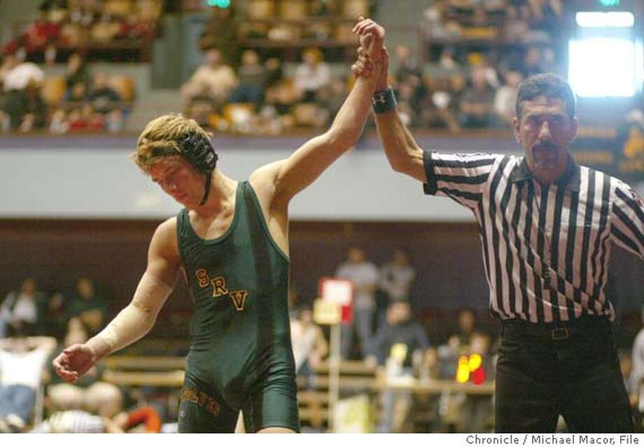 prepdigest081_mac.jpg David Christian of San Ramon Valley, picks up an easy second round victory over Nick Stirm of Northgate. North Coast Section Wrestling Tournament at the Henry J. Kaiser Convention Center in Oakland. event on 2/27/04 in Oakland Michael Macor / San Francisco Chronicle San Ramon Valley's David Christian (left) flips over his opponent, Northgate's Nick Stirm, who he defeated 13-0 in a major decision. San Ramon Valley's David Christian (left) flips over his opponent, Northgate's Nick Stirm, who he defeated 13-0 in a major decision. Mandatory Credit For Photographer and SF Chronicle/ - Magazines Out Photo: Michael Macor