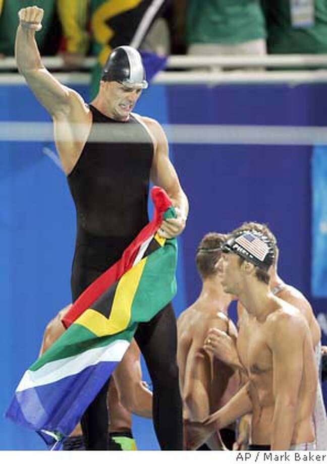 South African swimmer Ferns Lyndon reacts after his team won the 4x100m freestyle relay at the 2004 Olympic Games Sunday, Aug. 15, 2004 in Athens, Greece. At right is Michael Phelps of the U.S. The Americans finished third. (AP Photo/Mark Baker) Photo: MARK BAKER