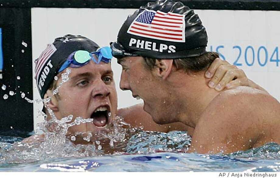 Michael Phelps, right, of the U.S. and teammate Erik Vendt of the U.S. embrace after finishing first and second respectively in the 400m individual medley at the Olympic Games Saturday, Aug. 14, 2004 in Athens, Greece. Phelps set a world record of 4:08.26. (AP Photo/Anja Niedringhaus) Photo: ANJA NIEDRINGHAUS