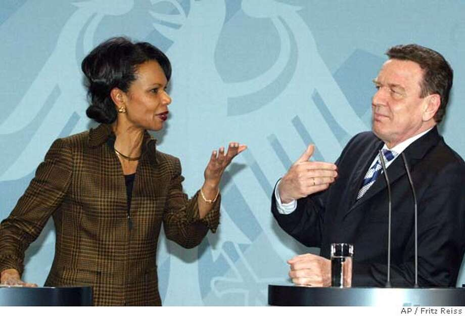 German Chancellor Gerhard Schroeder, right, talk with U.S. Secretary of State Condoleezza Rice, left, during the news conference after their talks in the Berlin Chancellery Friday, Feb. 4, 2005. (AP Photo/Fritz Reiss) Photo: FRITZ REISS