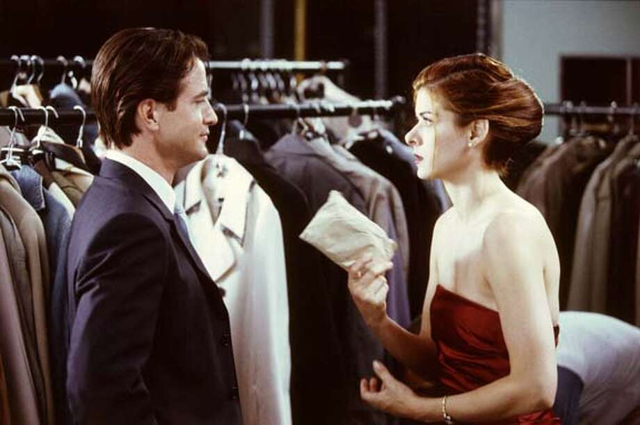 "In this photo provided by Universal Studios, Kat Ellis (Debra Messing) hires Nick Mercer (Dermot Mulroney) , a charming and handsome professional male escort, to be her date at her sister's wedding in the romantic comedy ""The Wedding Date"". (Universal Studios/Eugene Adebari) Photo: EUGENE ADEBARI."