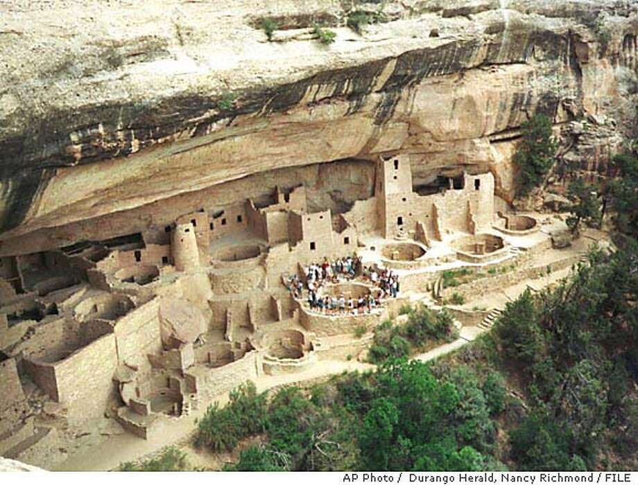 TRAVEL ** FOR IMMEDIATE RELEASE--FILE **Visitors tour the ruins at Mesa Verde National Park in Southwest Colorado in this early June, 1999 file photo. Mesa Verde National Park was established in 1906 as the first National Park in the state of Colorado. Today there are eleven sites including parks, monuments, and wilderness areas managed by the National Park service in Colorado, on land totaling 658,000 acres. (AP Photo/ Durango Herald, Nancy Richmond/FILE) FOR IMMEDIATE RELEASE. A 1999 FILE PHOTO. Photo: NANCY RICHMOND