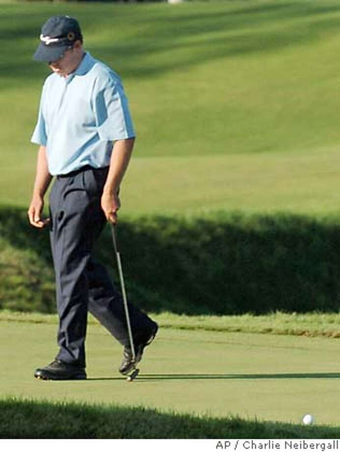 Justin Leonard reacts after missing a putt for par on the 18th green that have won the at Whistling Straits in Haven, Wis., on Sunday, Aug. 15, 2004. The bogey forced a playoff with Vijay Singh and Chris DiMarco. (AP Photo/Charlie Neibergall) Photo: CHARLIE NEIBERGALL