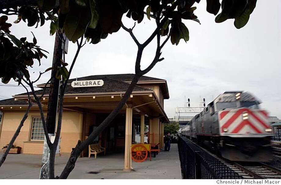 A CalTrain speeds past the museum after making a stop for passengers. The Millbrae train Museum has been open since the middle of December.1/15/05 Millbrae, Ca Michael Macor / San Francisco Chronicle Photo: Michael Macor