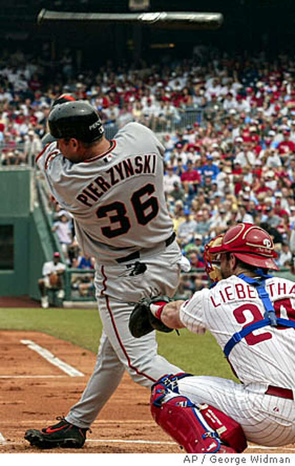 San Francisco Giants' A.J. Pierzynski loses his bat to the stands before flying out as Philadelphia Phillies catcher Mike Lieberthal watches in the first inning Sunday, Aug. 15, 2004, in Philadelphia. (AP Photo/George Widman) Photo: GEORGE WIDMAN