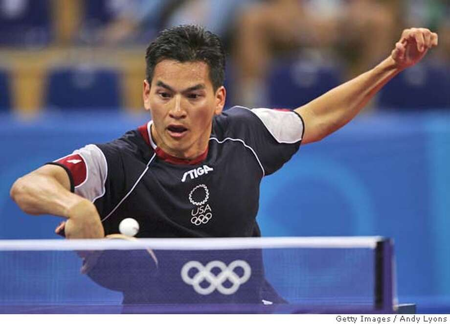 ATHENS - AUGUST 14: Khoa Nguyen of the United States hits a return during the men's singles table tennis match on August 14, 2004 during the Athens 2004 Summer Olympic Games at Galatsi Olympic Hall in Athens, Greece. (Photo by Andy Lyons/Getty Images) *** Local Caption *** Khoa Nguyen (CHINA OUT until Sep 12th 2004) (NEWSWEEK, US NEWS & WORLD REPORT OUT until Sep 12th 2004) Photo: Andy Lyons