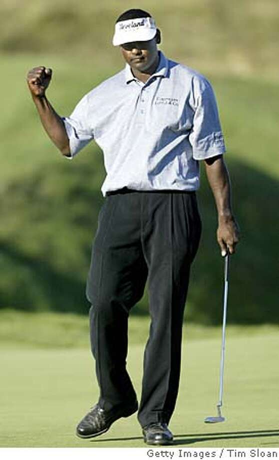 Vijay Singh makes a fist after sinking his putt on 18 to take the lead into tomorrows final round of the 86th PGA Championship at Whistling Straits Golf Course 14 August, 2004 in Kohler, Wisconsin. AFP PHOTO / TIM SLOAN (Photo credit should read TIM SLOAN/AFP/Getty Images) Photo: TIM SLOAN