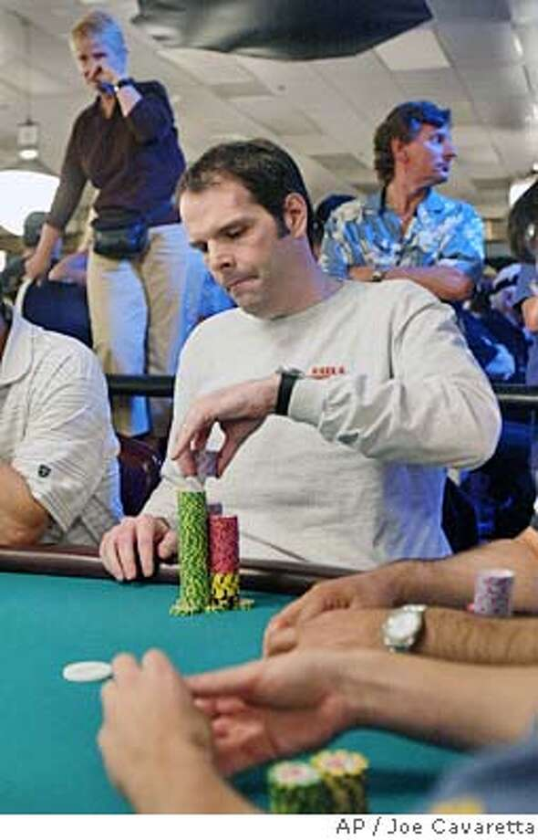 **FILE**Howard Lederer places a bet during the World Series of Poker in this May 24, 2004 file photo at Binion's Horshoe in Las Vegas. Poker players still will ply their trade in Deadwood, South Dakota in October, but it won't be on national television, promoters said. (AP Photo/Joe Cavaretta) Ran on: 08-15-2004  Howard Lederer places a bet during the 2004 World Series of Poker at Binion's Horseshoe in Las Vegas. Photo: JOE CAVARETTA
