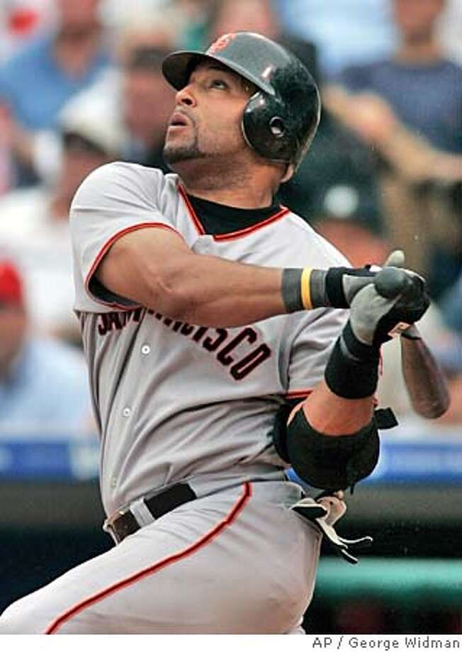 San Francisco Giants' Yorvit Torrealba hits a tiebreaking homer in the eighth inning, leading the San Francisco Giants over the fading Philadelphia Phillies 7-6 Saturday, Aug. 14, 2004, in Philadelphia.(AP Photo/George Widman) Photo: GEORGE WIDMAN