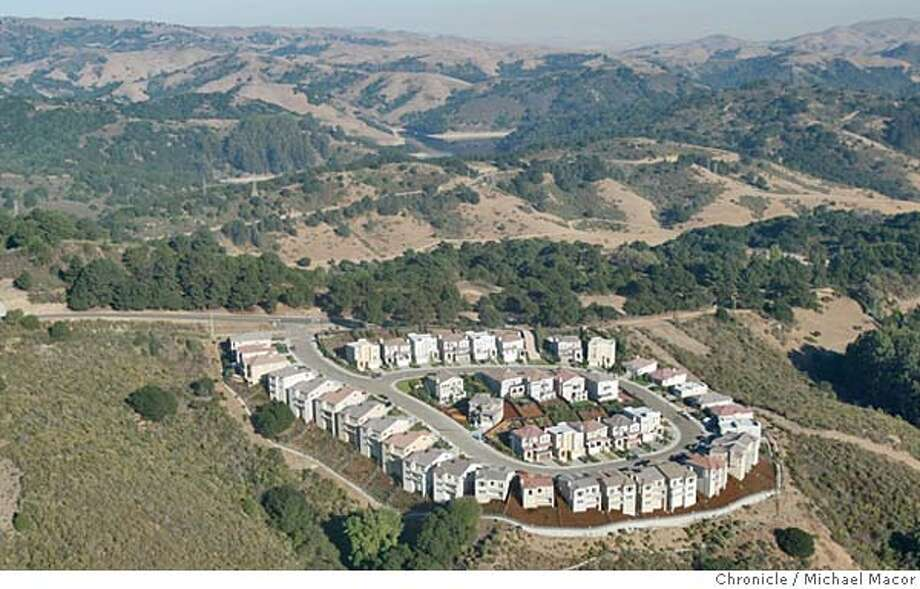 parkshelo197_mac.jpg A newer home development above the hills in San Leandro, sits above the Anthony Chabot Regional Park.  A view from the air with a ride along with the East Bay Parks helicopter Eagle 5. The East Bay Regional Parks system of the Bay Area encompasses more than 95,000 acres.  10/28/03 in Castro Valley. MICHAEL MACOR/ The Chronicle Ran on: 08-15-2004  From the air, a newer home development in the San Leandro hills overlooks Chabot Regional Park, part of the East Bay Regional Park District, which encompasses almost 96,000 acres. Photo: MICHAEL MACOR
