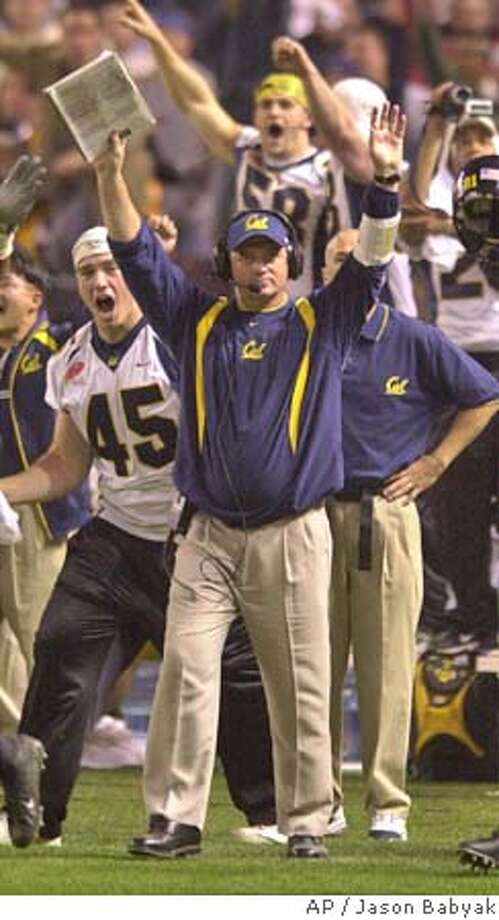 California coach Jeff Tedford celebrates the team's 52-49 win over Virginia Tech at the Insight Bowl, Friday, Dec. 26, 2003, in Phoenix. (AP Photo/Jason Babyak) The Bears go wild after locking up their first postseason win since 1993. Below, Tyler Fredrickson is carried off the field after booting the game-winner. The Bears go wild after locking up their first postseason win since 1993. Below, Tyler Fredrickson is carried off the field after booting the game-winner. Photo: JASON BABYAK