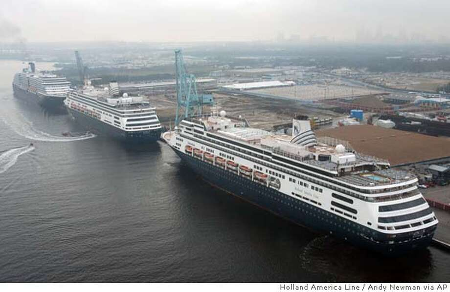 In this photo, released by Holland America Line, the Seattle-based cruiseline's ships including, from left, Zuiderdam, Zaandam and Volendam are tied at JaxPort in Jacksonville, Fla., after arriving Thursday, Feb. 3, 2005, to serve as floating hotels for Super Bowl XXXIX. The three Holland America ships and two others are providing about 3,600 extra rooms, primarily to accommodate NFL officials and VIPs from top league sponsors. (AP Photo/Holland America Line, Andy Newman) Photo: ANDY NEWMAN