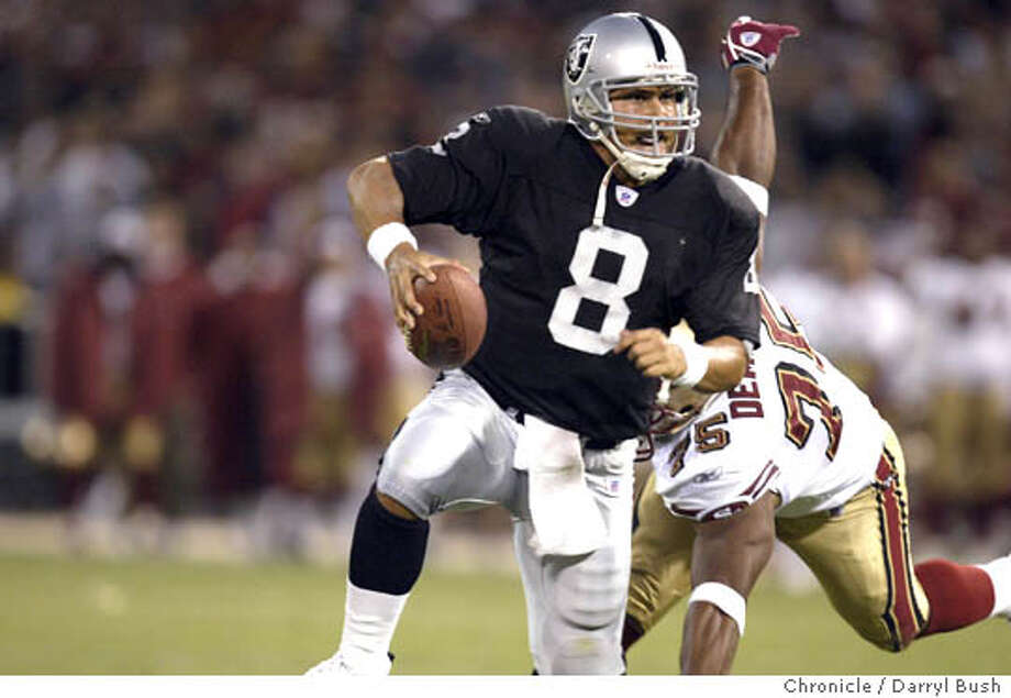 Oakland Raiders Marcus Tuiasosopo evades Raiders Chris Demaree (75) in the 4th quarter as the Raiders went deep enough to score a go ahead field goal vs. San Francisco 49ers at 3com stadium. 8/14/04 in San Francisco  Darryl Bush / The Chronicle Photo: Darryl Bush