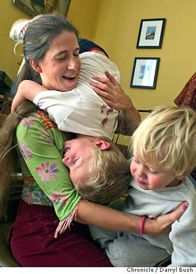 jam_077_db.jpg  Musician Charity Kahn and her kids, Jasper Crocker, 5, left (upside down) and Silas Crocker, 2, play together as music is played in their home. 8/6/04 in San Francisco  Darryl Bush / The Chronicle MANDATORY CREDIT FOR PHOTOG AND SF CHRONICLE/ -MAGS OUT Photo: Darryl Bush