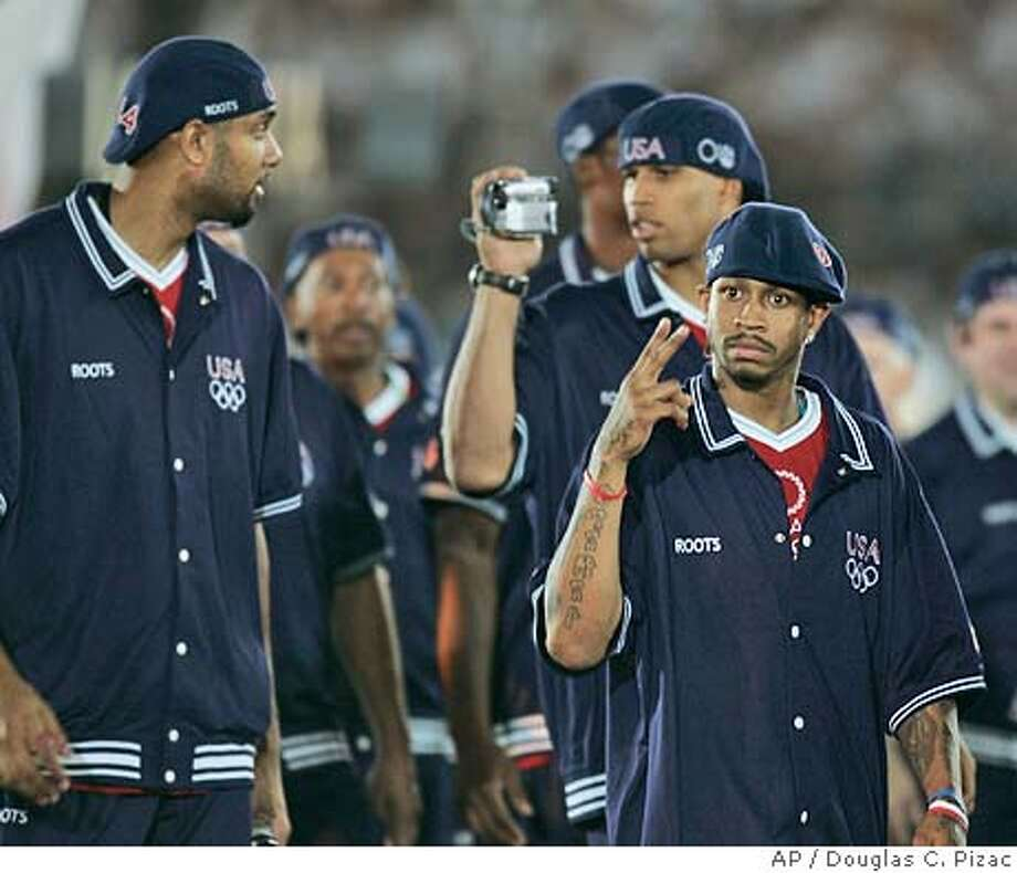 USA's Allen Iverson, of the Philadelphia 76ers, gestures while Richard Jefferson, of the New Jersey Nets, videotapes Tim Duncan, left, of the San Antonio Spurs, during the opening ceremony of the Summer Olympics in Athens Friday, Aug. 13, 2004. (AP Photo/Douglas C. Pizac) Photo: DOUGLAS C. PIZAC