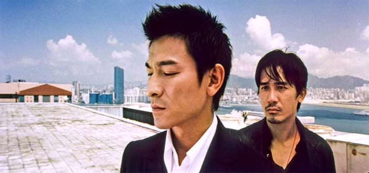 Film still of Andy Lau, left, and Tony Leung in