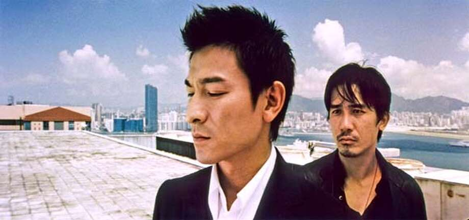 """Film still of Andy Lau, left, and Tony Leung in """"Infernal Affairs."""""""