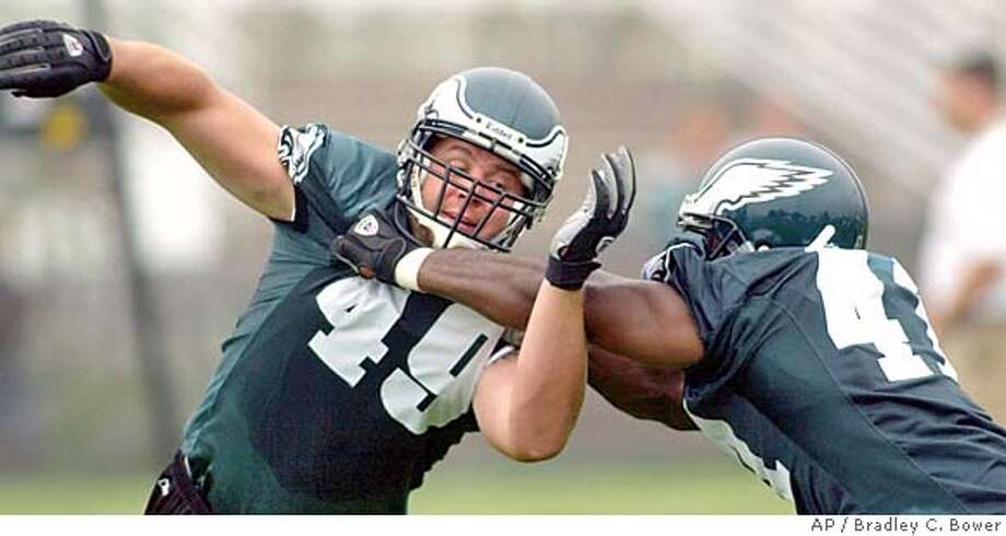 Philadelphia Eagles fullback Josh Parry (49) works a blocking drill with teammate rookie Thomas Tapeh (41), Friday, July, 30, 2004, at the team's training facility in Bethlehem, Pa. (AP Photo/Bradley C. Bower) Photo: BRADLEY C BOWER