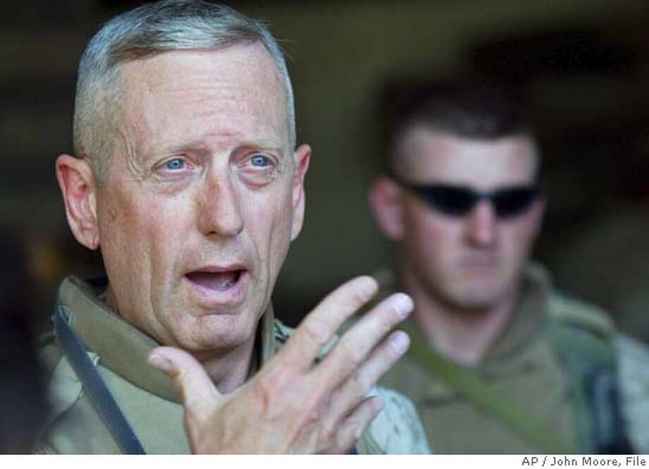 "** FILE ** James N. Mattis, Major General in charge of the US 1st Marine Division, speaks to the media in Fallujah, Iraq in a file photo from April 14, 2004. The decorated Marine Corps general said, ""It's fun to shoot some people"" and poked fun at the manhood of Afghans as he described the wars U.S. troops are fighting in Iraq and Afghanistan. (AP Photo/John Moore, File) AN APRIL 14, 2004 FILE PHOTO Photo: JOHN MOORE"