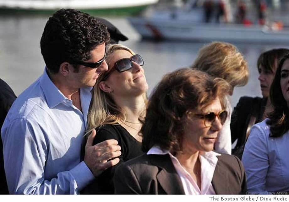 (NYT13) BOSTON -- July 30, 2004 -- KERRY-5 -- Teresa Heinz Kerry's son Christopher, left, hugs his stepsister, Vanessa Kerry, at a small rally for Democratic presidential candidate Sen. John Kerry at Langone Park in Boston, Friday, July 30, 2004. Teresa Heinz Kerry is in right foreground. Kerry and running mate John Edwards plunged into the general election and embarked Friday on a coast-to-coast campaign swing through 21 states aimed at convincing millions of undecided voters that he will stand up for ordinary Americans. (Dina Rudick/The Boston Globe) Ran on: 08-15-2004  Teresa Heinz Kerry: resembling Greta Garbo? Photo: Dina Rudick