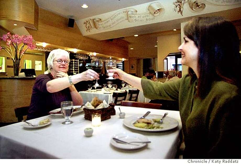 SHOWN: Le Theatre is a French-California restaurant in the Berkeley Arts District, popular with theater goers. We find Susan Griffin (L), author of THE BOOK OF THE COURTESANS, toasting her friend Joan Marler (R), a scholar and writer. EBAYLIFE Friday restaurant review. Katy Raddatz / The Chronicle Photo: Katy Raddatz