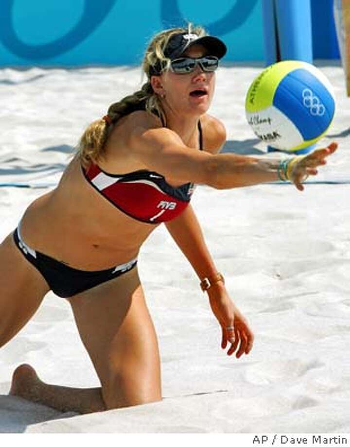 The United States player Kerri Walsh dives for the ball during practice for the 2004 Olympics Beach Volleyball competition in Athens, Greece on Thursday, Aug. 12, 2004. (AP Photo/Dave Martin) Photo: DAVE MARTIN